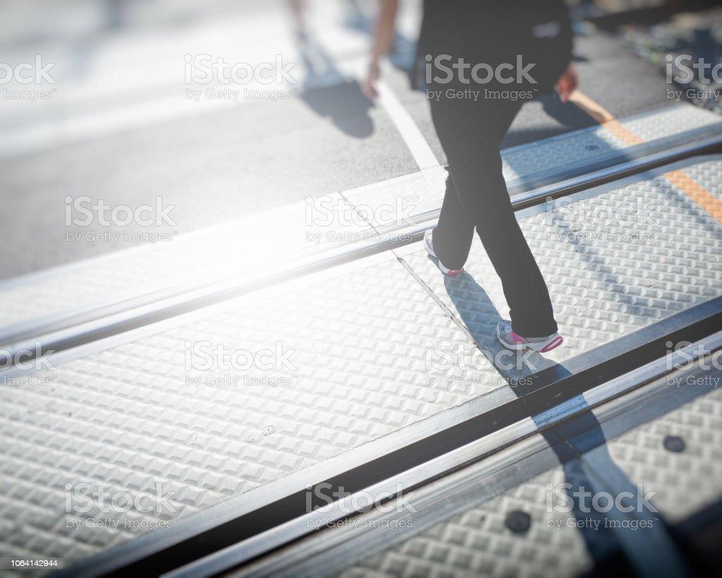 Walking over Railway Lines stock photo