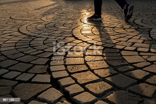 walking pace on ground at sunset