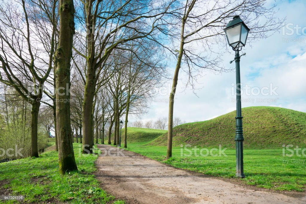 walking path with trees and lanterns in  fortified city Geertruidenberg, The Netherlands stock photo