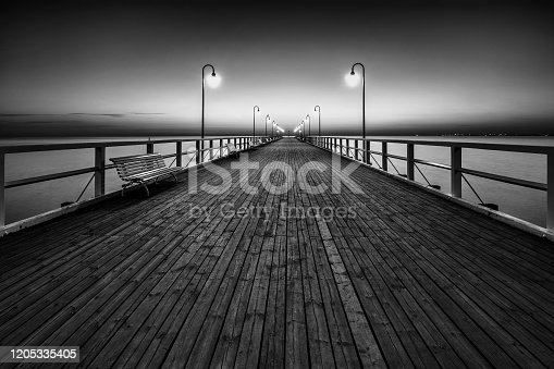 Walking pier. Poland, Gdynia Orlowo, Baltic Sea black and white