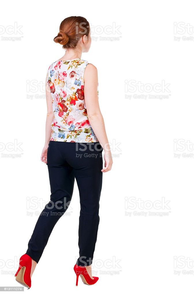 walking red head business woman. stock photo