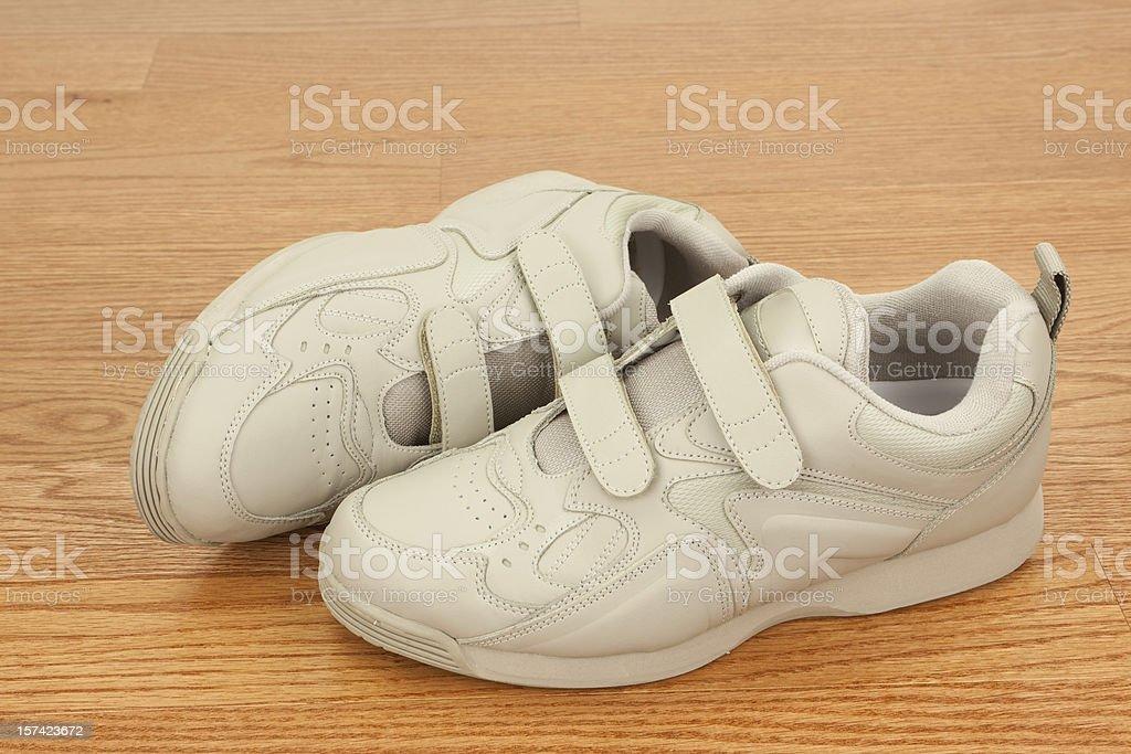 Walking Shoes on Wood Floor stock photo