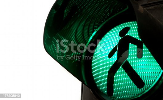 Traffic lights with the green light lit.