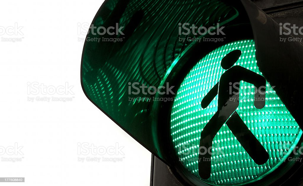 Walking signal turns green on a traffic light  stock photo