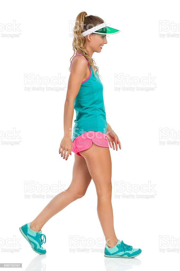 Walking Sport Girl In Sun Visor Full Length stock photo