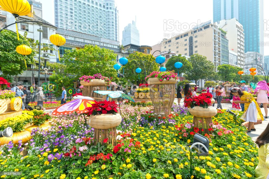 Walking street morning Lunar New Year at downtown with flowers decorated along street stock photo
