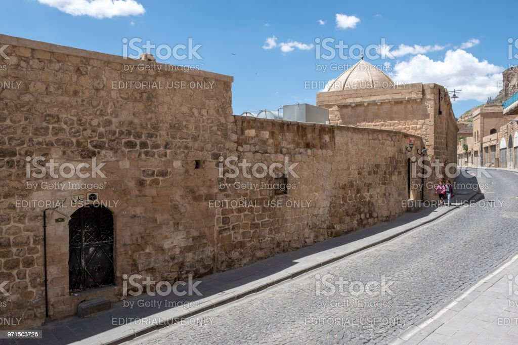 Walking studentds on road in Mardin stock photo