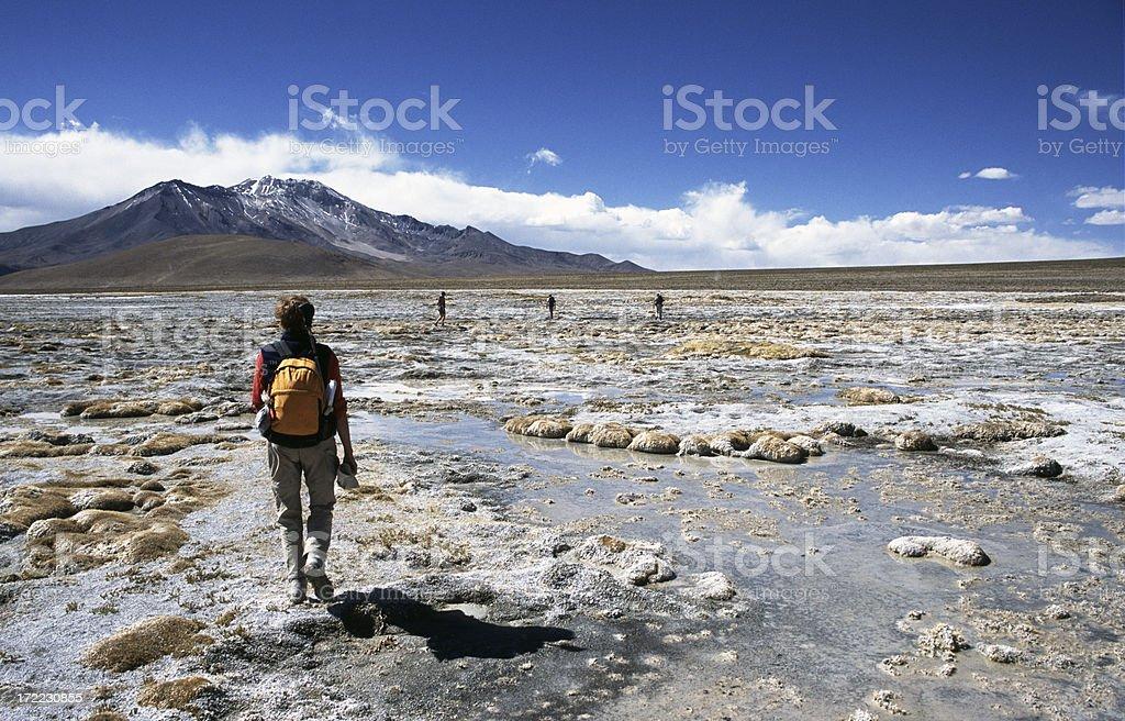 Walking throug a salt lake in the Atacama desert stock photo