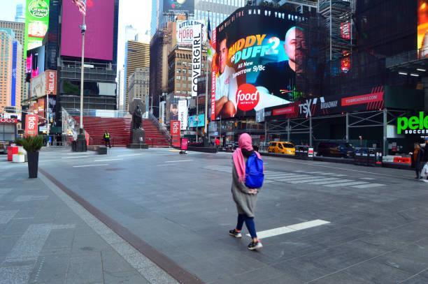 Walking through an empty Times Square stock photo