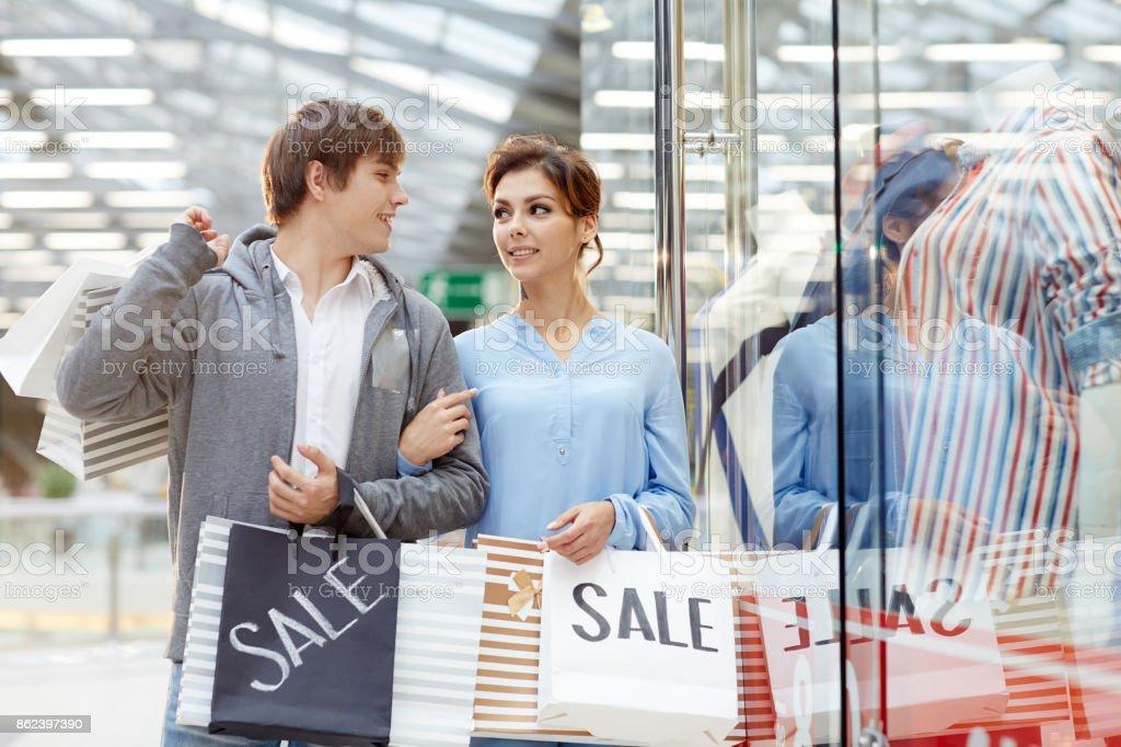 Walking through clothing shop-window stock photo
