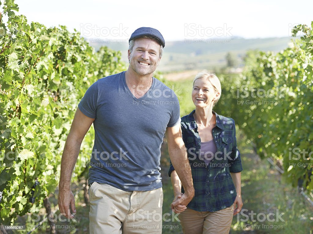 Walking through the vines together royalty-free stock photo