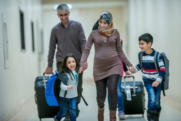 walking to a new home - emigration and immigration stock photos and pictures