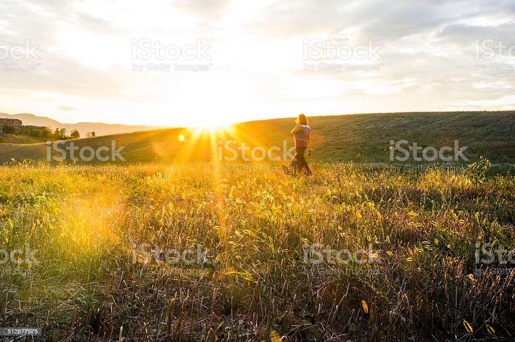 Walking to the sun stock photo