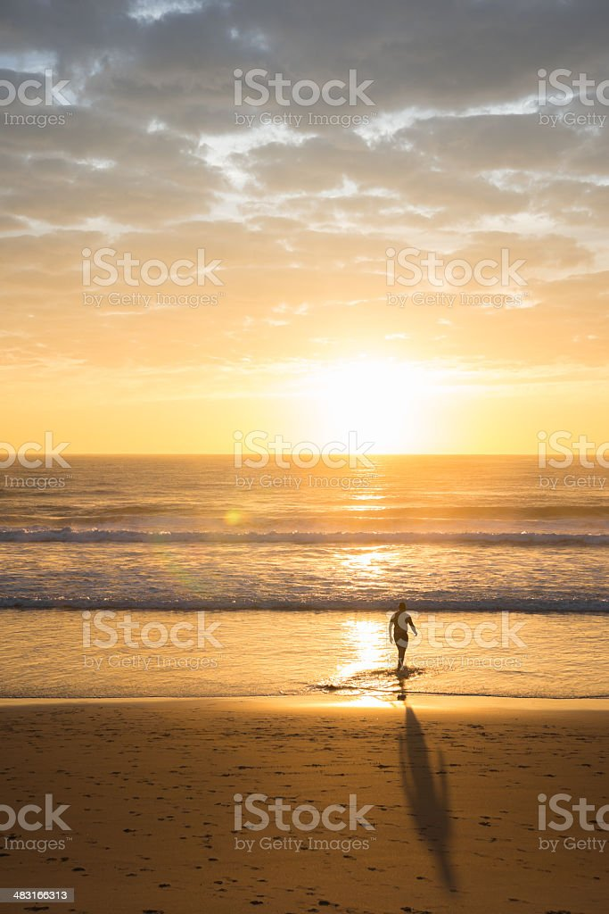 Walking to the sunrise stock photo