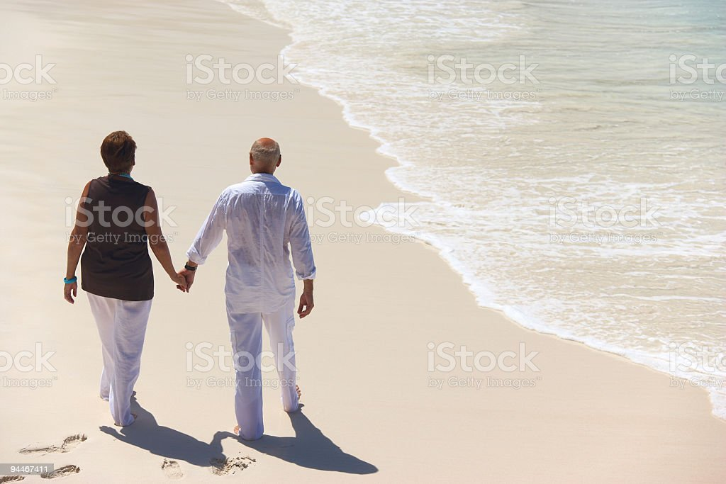 walking together on the beach royalty-free stock photo