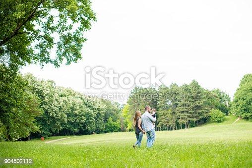 istock Walking trough grass 904502112