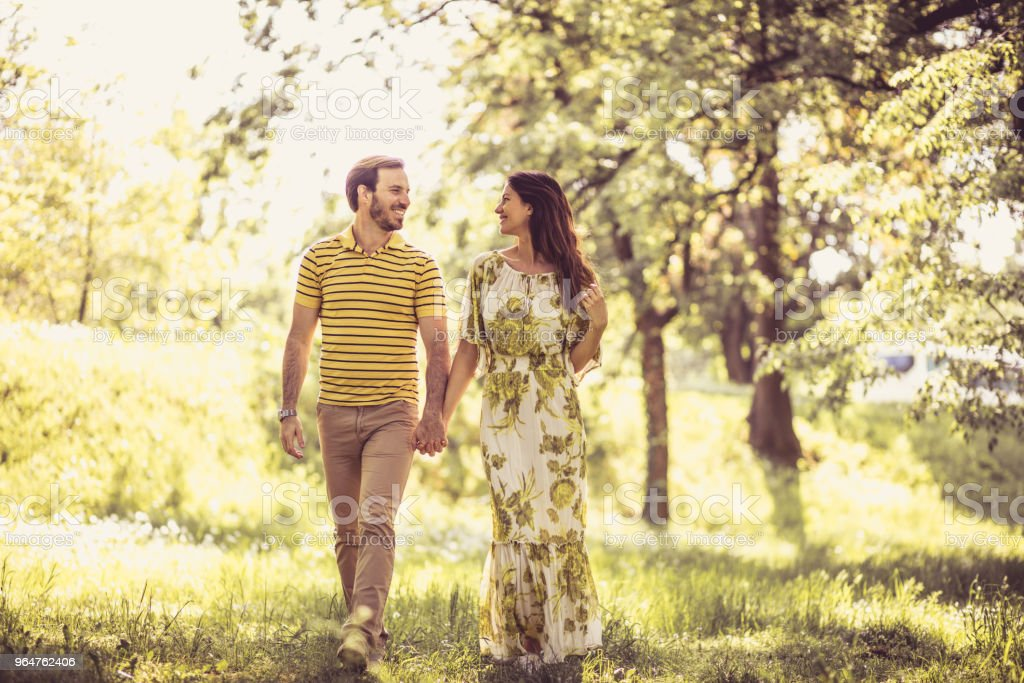 Walking trough nature. Couple in love. royalty-free stock photo
