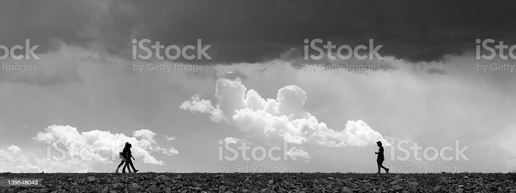 walking under the storm royalty-free stock photo