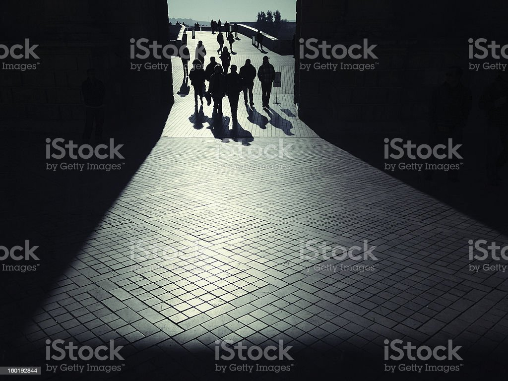 Walking under triumphal arch royalty-free stock photo