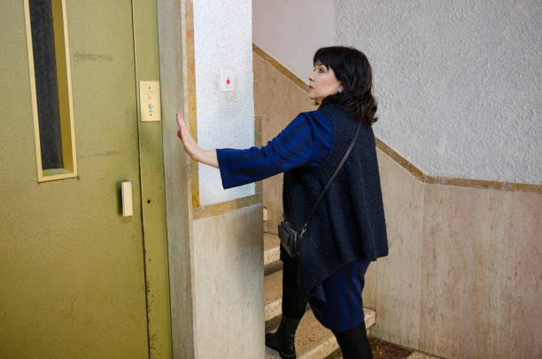 Walking up stairs is healthier than using an elevator stock photo