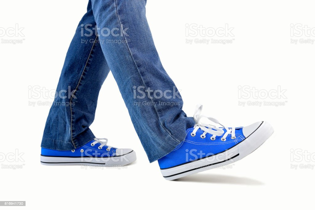 walking with sneakers stock photo