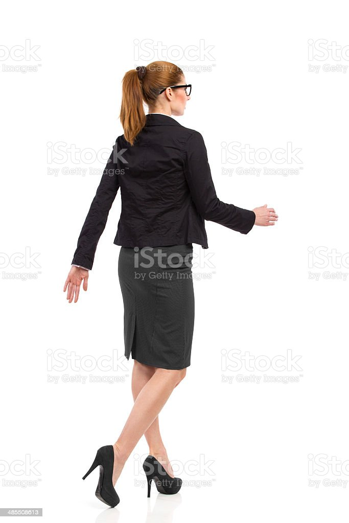 Walking woman, rear angle view. stock photo