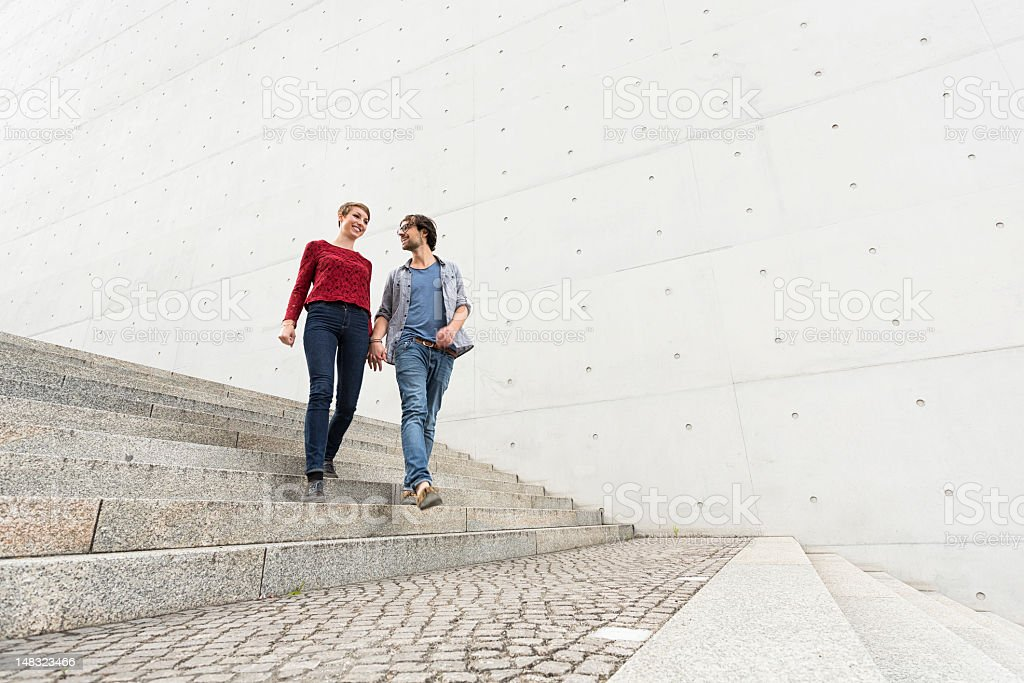 Walking young couple stock photo