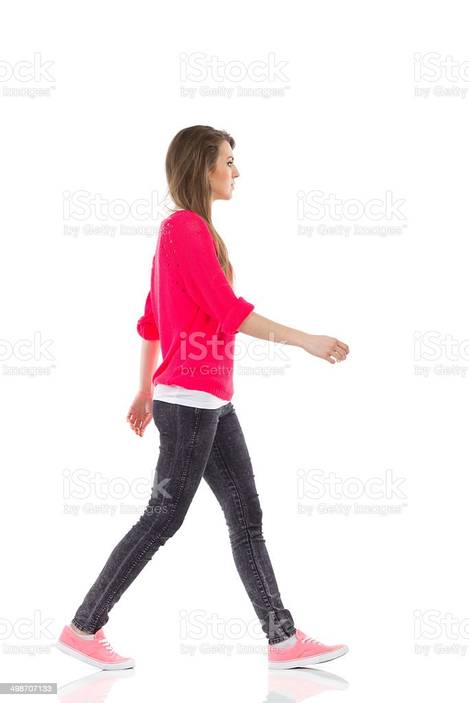 Walking young woman stock photo