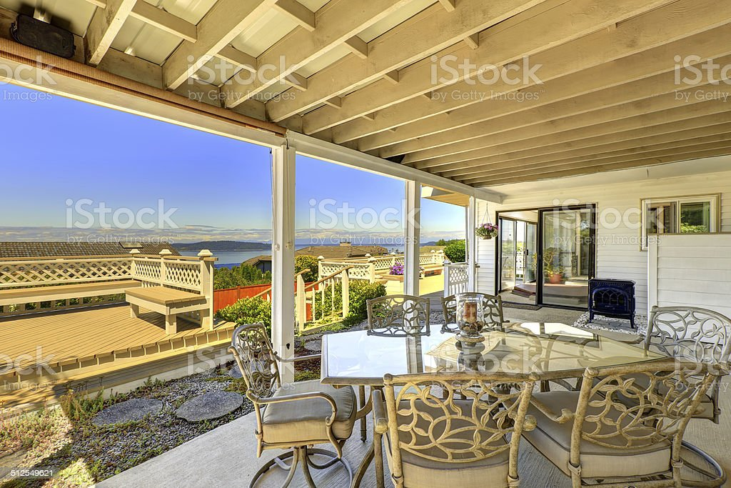 Walkout deck with patio area and scenic bay view stock photo