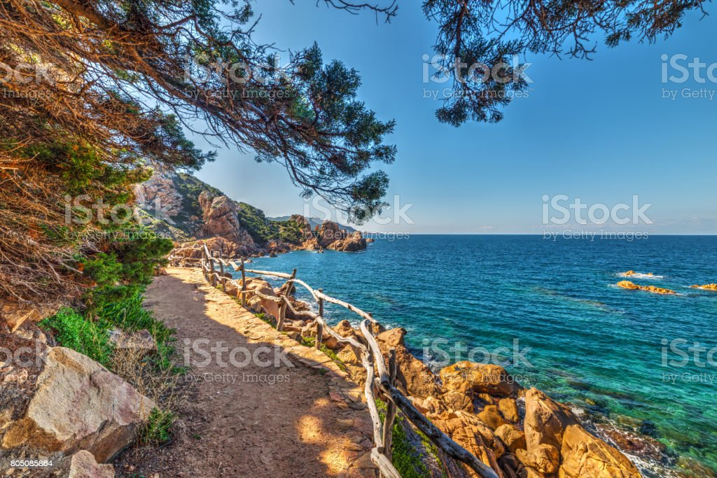 Walkpath by the shore in Costa Paradiso stock photo