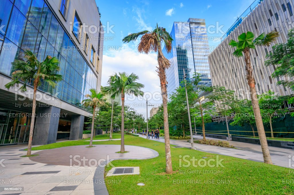 Walkway at a park and skyscrapers at Bonifacio Global City on Sep 1, 2017 in Taguig, Manila, Philippines stock photo