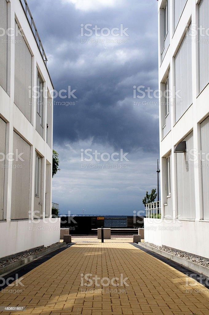 walkway between houses royalty-free stock photo