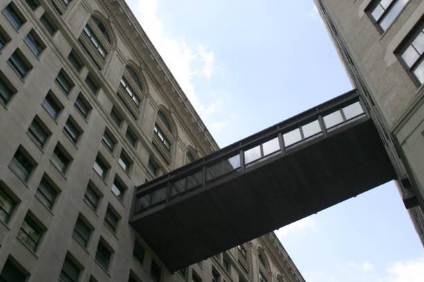 walkway between two buildings in NYC stock photo