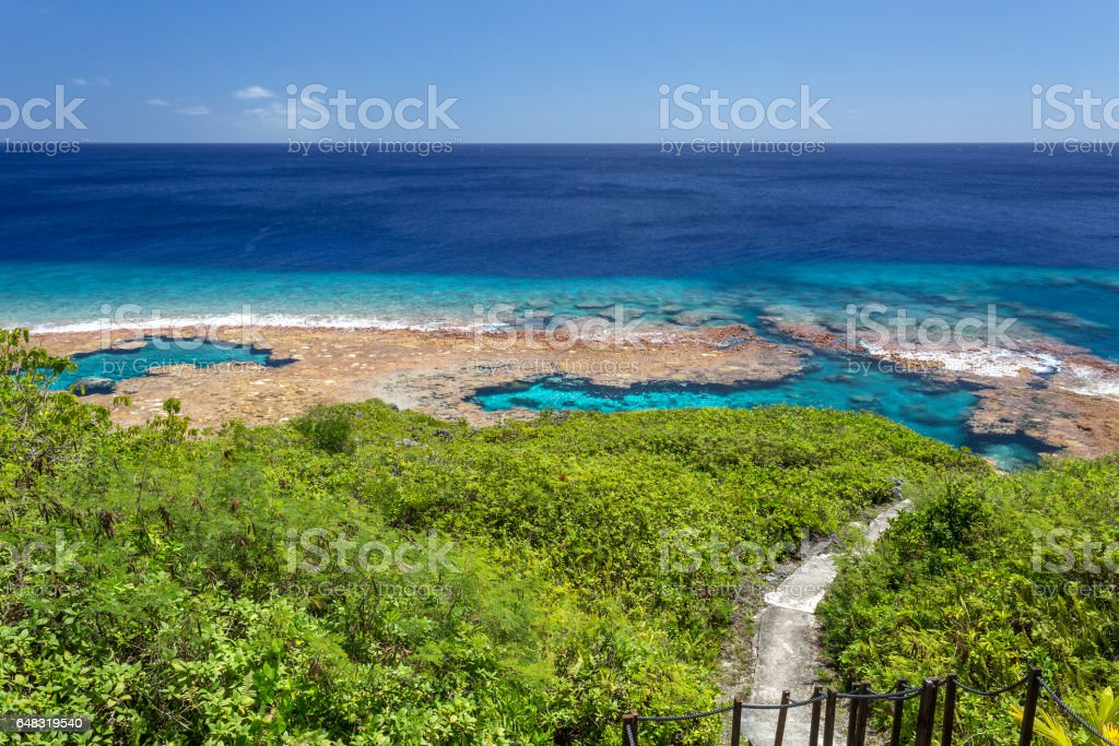 Walkway down to reef flats and tidal pools, in Niue, South Pacific Ocean stock photo