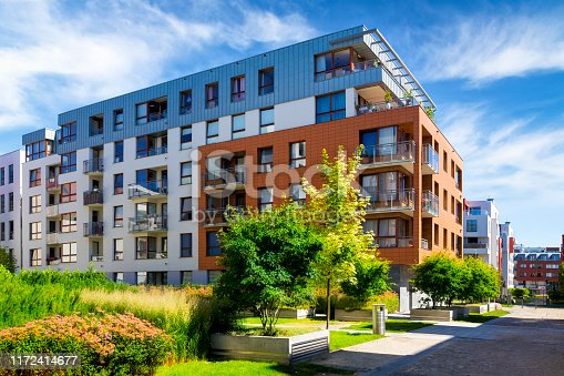 889473004 istock photo Walkway leading along the new colorful cmplex of apartment buildings 1172414677