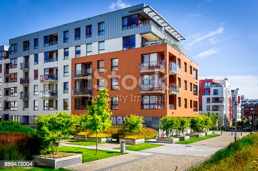 Walkway leading along the new colorful cmplex of apartment buildings, Gdansk, Poland