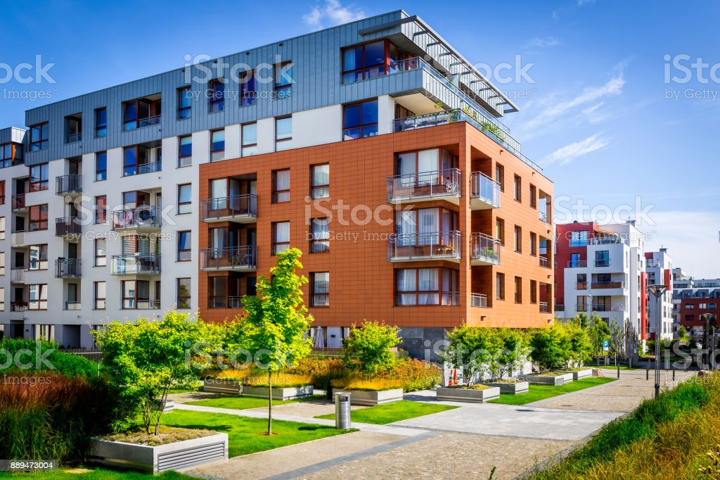 Walkway leading along the new colorful cmplex of apartment buildings stock photo
