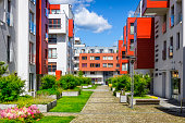 istock Walkway leading along the new colorful housing estate 884945196