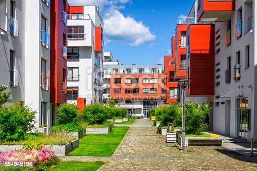 889473004 istock photo Walkway leading along the new colorful housing estate 884945196