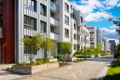 istock Walkway leading along the new complex of apartment buildings 1276801276