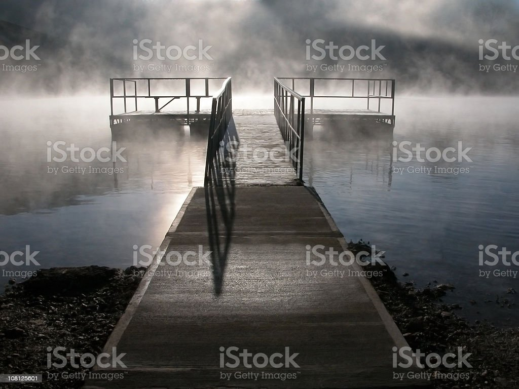 walkway leading to a dock within fog royalty-free stock photo