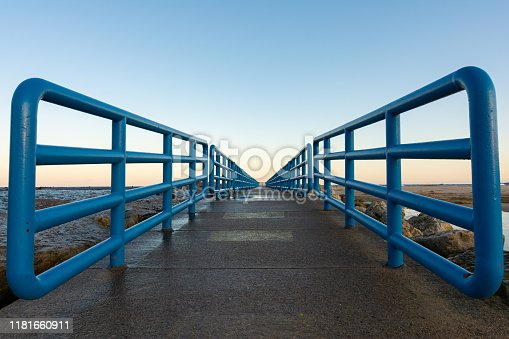 istock Walkway leading to the breakwater as the sun rises on Lake Michigan.  Holland, Michigan, USA 1181660911