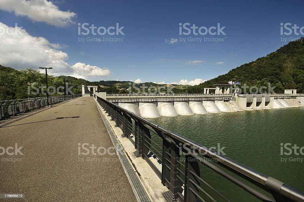 Walkway of a dam on the river Tidone royalty-free stock photo