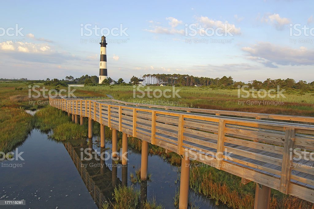 Walkway over a marsh to the Bodie Island lighthouse stock photo