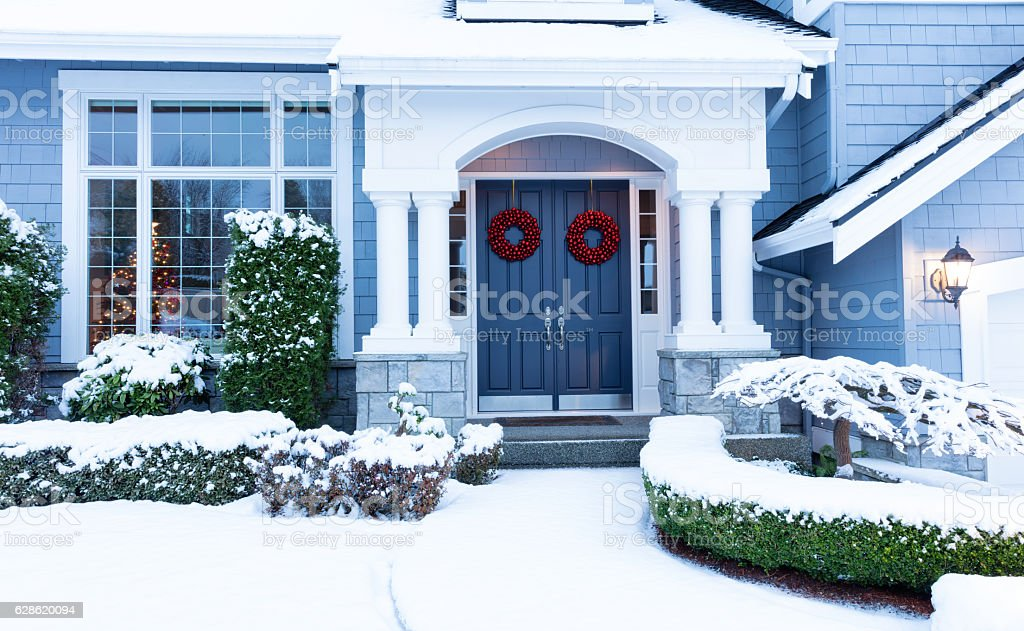 Walkway to home decorated for the winter holidays stock photo