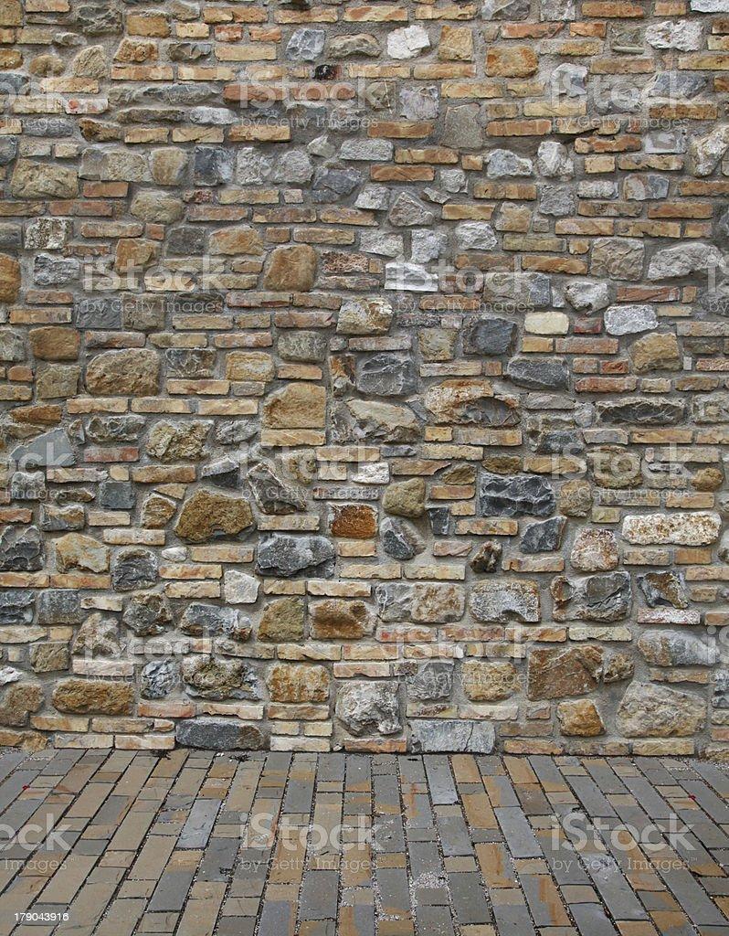 Walkway with stone wall stock photo