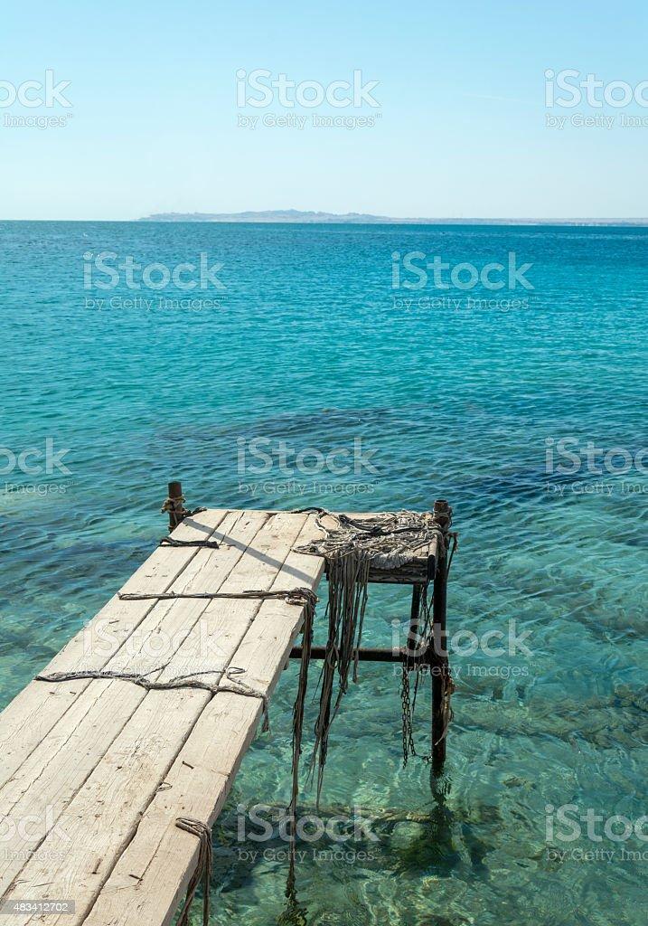 walkways on the sea and blue sky stock photo