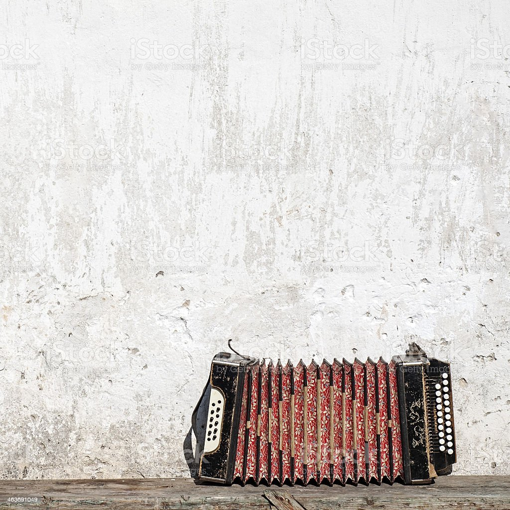 wall and accordion on the bench stock photo