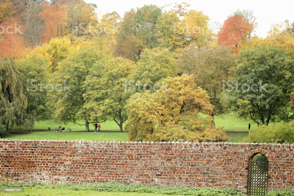 Wall and Autumn trees royalty-free stock photo