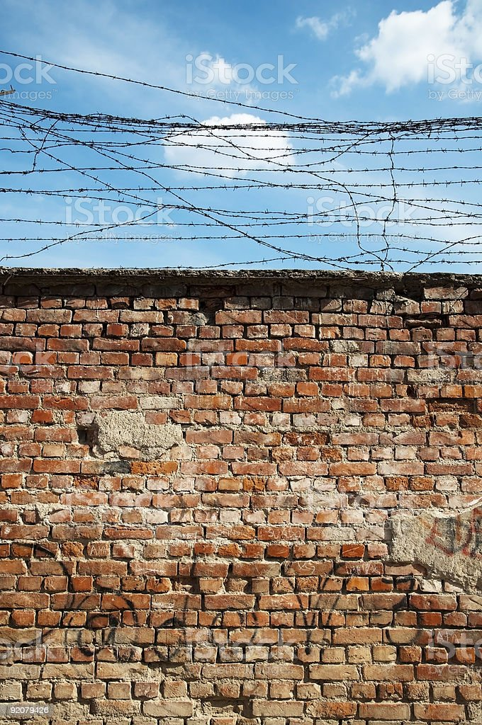 Wall and barbed wire royalty-free stock photo